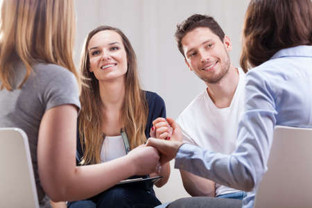 Addicted people having good time together on special group therapy photo
