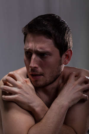 throbbing: Frustrated man sick on schizophrenia in mental hospital