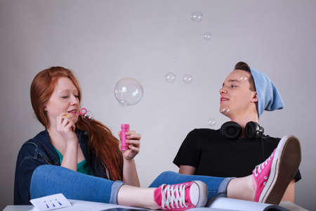 unkind: Naughty teenagers boring and let bubbles at school