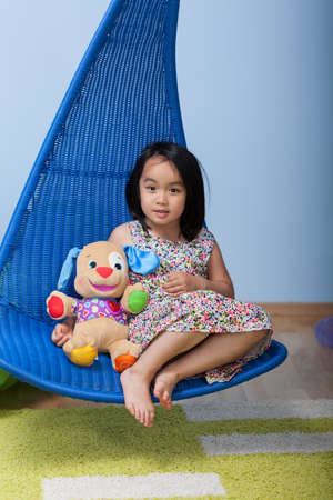 favourite: Asian girl with favourite bear at home