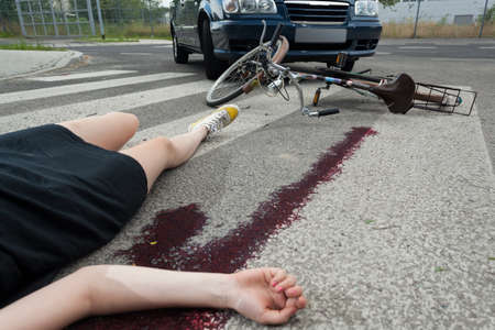 Dead woman after car accident on the street photo