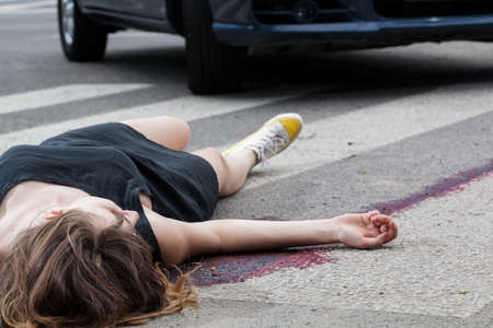 dissociation: Horizontal view of woman hit by a car