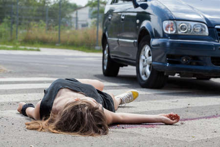 Horizontal view of car hit young woman photo