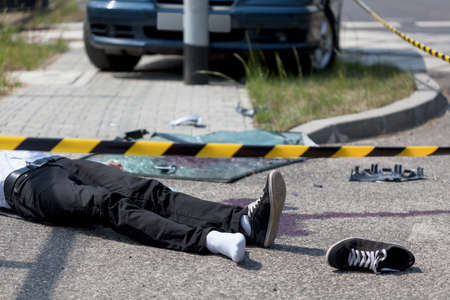 accident dead: Horizontal view of male victim of car crash Stock Photo