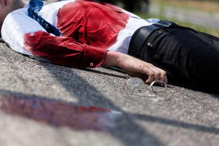 Dead bleeding man after car accident, horizontal