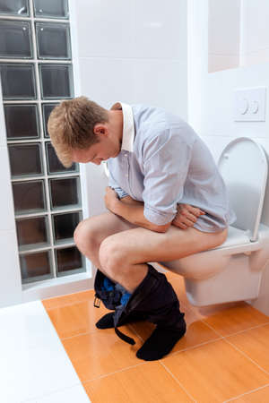 Man during morning toilet at home, vertical photo