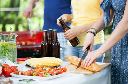 Young people enjoying good barbecue party in garden photo