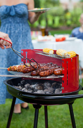 garden barbecue: Good summer barbecue garden party with friends  Stock Photo