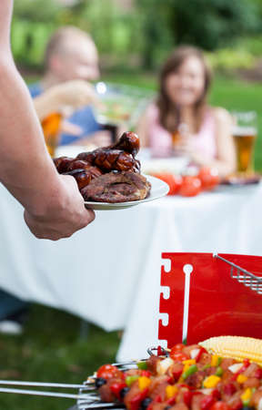 Sunny barbecue day with friends and delicious food  photo
