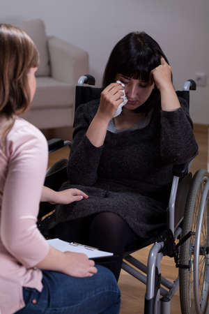 disability insurance: Disabled woman and her therapist at home