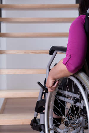 upstairs: Disabled woman cant get upstairs at home Stock Photo
