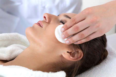 cleanse: Close-up of woman during facial cleansing in spa Stock Photo