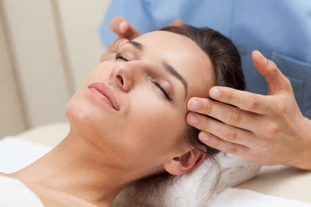 pleasant: Pleasant head massage in spa room, horizontal Stock Photo