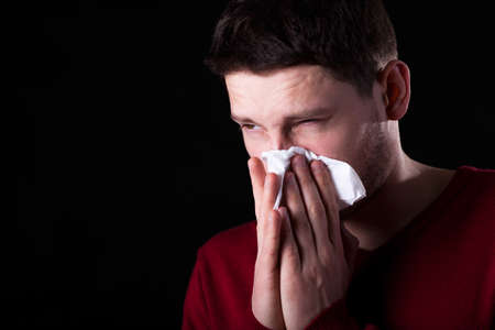 throe: Horizontal view of man with runny nose Stock Photo