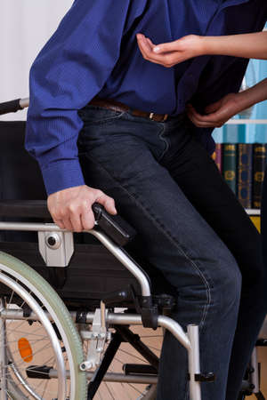 get help: Disabled gets up of the truck with the help of a nurse