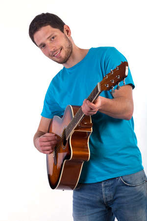 Guitar player isolated on white background, vertical photo