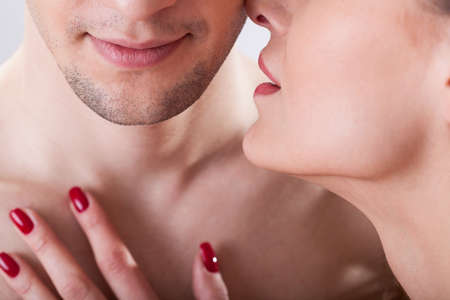 young sex: Portrait of young lovers having intimate moment Фото со стока