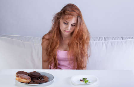 anorexia: Horizontal view of dieting girl in her room Stock Photo
