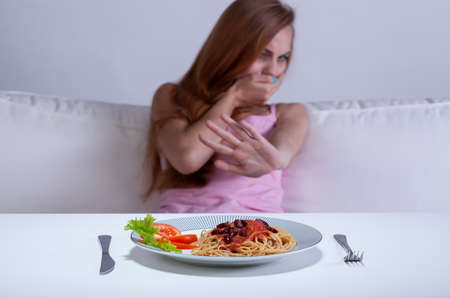 View of dieting girl cant eat dinner Stock Photo