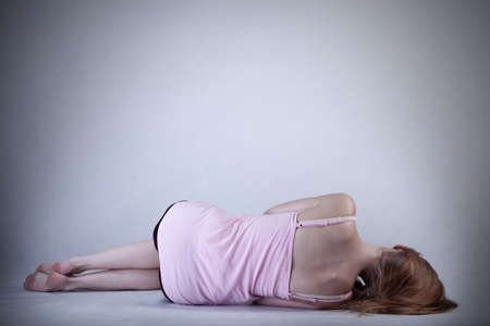 Skinny girl lying on the floor, horizontal photo