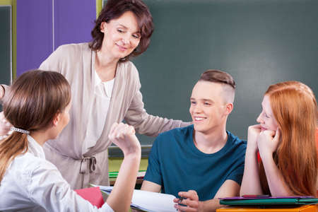college professor: Students working in group on lesson, horizontal