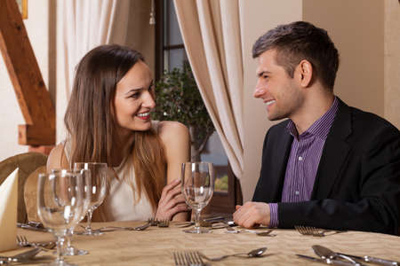 love affair: Happy couple having dinner in a restaurant Stock Photo