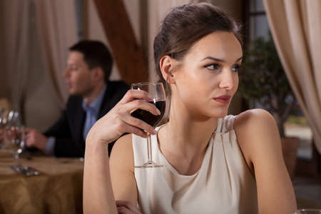 single woman: Single woman drinking red wine in a restaurant