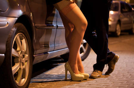 Man flirting with prostitute on the street photo