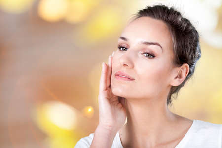 day spa: View of beautiful woman admiring her face Stock Photo