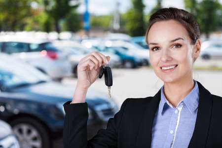 car park: Horizontal view of businesswoman with car keys