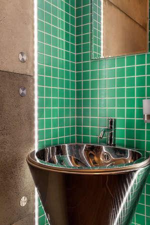 Sink in a modern green bathroom, vertical Stock Photo - 30492146