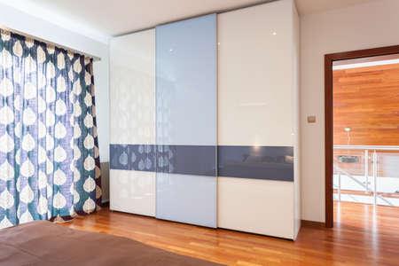 View of wardrobe in modern, new bedroom