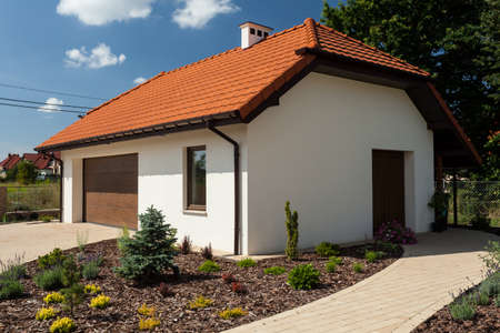 Horizontal view of the outbuilding with garage photo