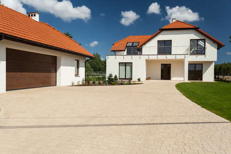 outbuilding: Modern house and outbuilding with garage, horizontal