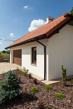 outbuilding: Outbuilding and small part of garden, vertical Stock Photo