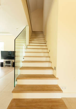 Vertical view of wooden stairs at home photo
