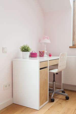 Vertical view of desk in girls room photo