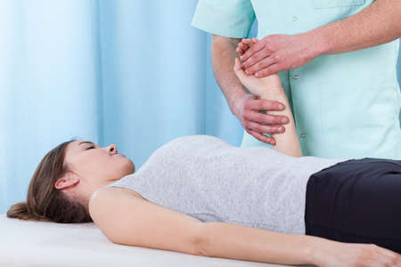 musculoskeletal: Physiotherapist treating the wrist after the injury