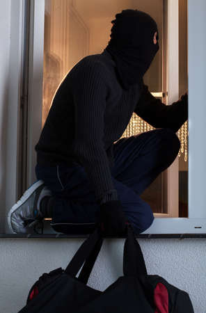 swindler: Vertical view of a robber after burglary