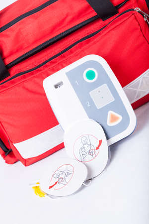 arrhythmias: Closeup of defibrillator in first aid kit Stock Photo