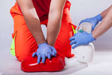 Demonstration of giving first aid after accident Stock Photo