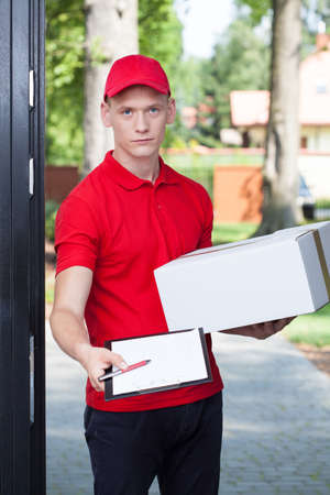 requesting: Vertical view of a delivery man requesting a signature