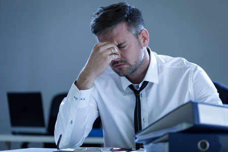 tired businessman: View of tired businessman in the office