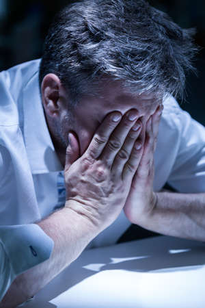 distraught: View of distraught man in the office Stock Photo