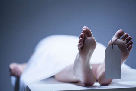 human toe: Labeled remains of person lying in mortuary Stock Photo