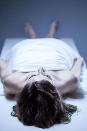 dead end: Vertical view od dead body of woman Stock Photo
