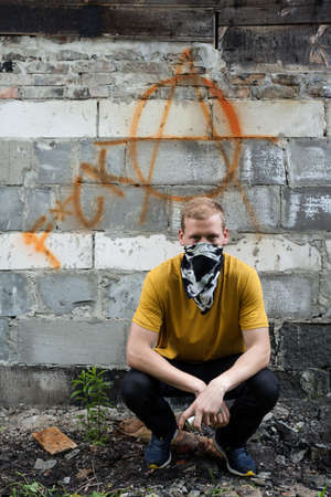 Portrait of young rebel on graffiti background photo