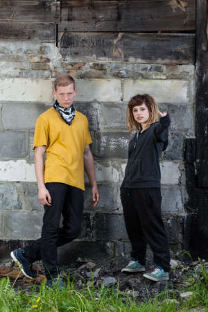 vandalize: Two young rebels standing next to the wall Stock Photo