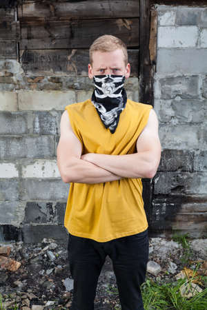 Portrait of angry young rebel with bandana on face Stock Photo