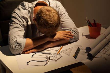 View of sleepy architect resting at night photo